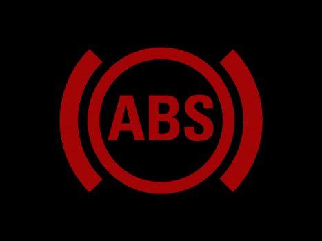 Надпись ABS в красном круге и скобки по бокам